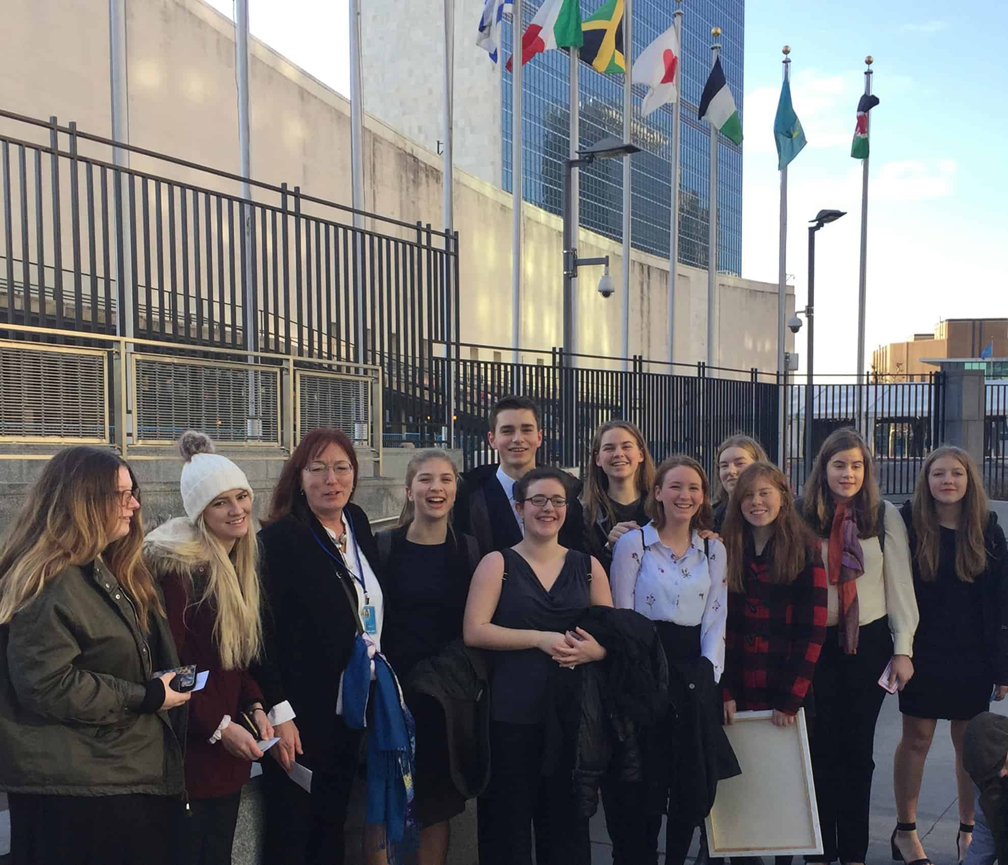 The Trumansburg team awaiting entrance to the UN prior to the final session of the Student Leadership Conference. Shown are (left to right) Arianna Wright, Zoe Golden, Gertrude Noden, Sarah Wertis, Logan Bonn, Georgia Mechalke, Jadyn Wright, Lilian Oxley, Margaret McCurdy, Virginia Clifford, Elizabeth Gardner, and Clair Williamson.